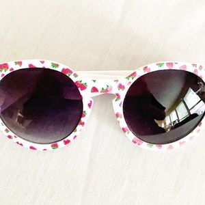 White sunglasses with strawberry graphic